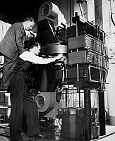 0076069 © Granger - Historical Picture ArchiveSYNCHROTRON, 1946.   Dr. Herbert Pollock and Dr. Frank Elder of General Electric adjust a 70-million volt synchrotron (atom-smasher), the first of its kind in the Americas, December 1946.