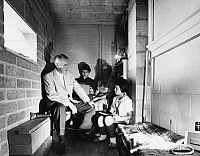 0128779 © Granger - Historical Picture ArchiveUSA: BOMB SHELTER, 1959.   Leo A. Hoegh, director of the office of Civil and Defense Mobilization, with his family in the bomb shelter in the basement of their home in Washington, D.C. during a test alert, June 1959.