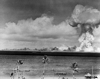 0171888 © Granger - Historical Picture ArchiveATOMIC BOMB TEST, 1946.   Test of the Able atomic bomb at Bikini Atoll in the Pacific Ocean, 1 July 1946. Fires can be seen on several ships.