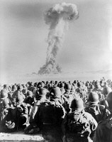 0622053 © Granger - Historical Picture ArchiveATOMIC BOMB TEST, 1951.   Members of the 11th Airborne Division of the U.S. Army watch an atomic bomb test at Frenchman Flat in Nevada, 1951.
