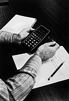 0115224 © Granger - Historical Picture ArchivePOCKET CALCULATOR, c1975.   A Hewlett-Packard HP 65 pocket calculator being used to make financial calculations. Photographed c1975.