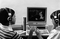 0114970 © Granger - Historical Picture ArchiveEDUCATION: COMPUTERS, 1983.   American children learning to read with the help of an IBM computer, using a program that combines text, graphics, and audio instruction. Photographed c1983.