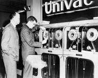 0622580 © Granger - Historical Picture ArchiveCOMPUTER: UNIVAC, 1959.   Man preparing a Univac computer to pick a winning horse. Photograph by Herman Hiller, 1959.