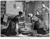 0095886 © Granger - Historical Picture ArchiveIRELAND: HAND MILL, 1874.   Irish peasant women using a hand mill to grind cereal grain into flour. Wood engraving, English, 1874.
