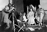 0126359 © Granger - Historical Picture ArchiveFILM SET, 1922.   Margaret Gorman, Miss America of 1921, and Stephen Fegan on set while filming a burlesque about the burning of Rome, 1922.