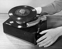 0034339 © Granger - Historical Picture ArchiveRCA PHONOGRAPH, 1949.   The RCA Victor seven-inch, 45 RPM phonograph record introduced in January 1949.