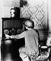 0175881 © Granger - Historical Picture ArchiveRADIOLA RADIO, c1925.   Woman tuning an RCA Radiola Super VIII radio. Photograph, c1925.