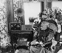 0175883 © Granger - Historical Picture ArchiveRADIO, c1920.   A woman listening to the radio. Photograph, c1920.