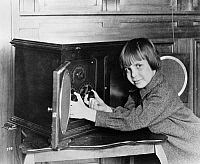 0175885 © Granger - Historical Picture ArchiveJACKIE COOGAN (1914-1984).   American actor. Coogan tuning an RCA Radiola IV radio, c1923.