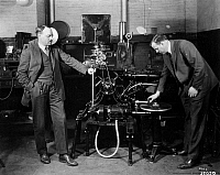 0174689 © Granger - Historical Picture ArchiveFILMMAKING: SOUND.   Henry Stoller and Harry Pfannenstiehl with the first commercial machine for synchronizing recorded sound with motion picture projection. Photograph, c1923.