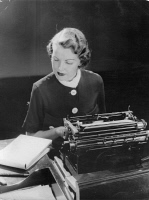0621919 © Granger - Historical Picture ArchiveTYPIST, 1933.   A typist working at a typewriter. Photograph, 1933. Full Credit: ullstein bild - Imagno / Austrian Archives (S) / Granger, NYC. All Rights Reserved.