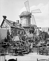 0131132 © Granger - Historical Picture ArchiveNEW YORK: WINDMILL, c1905.   A group of people posing in front of the windmill at Hammerstein's Paradise Gardens, New York. Photograph, c1905.