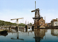 0131137 © Granger - Historical Picture ArchiveHOLLAND: WINDMILL.   View of Catharine Bridge and windmill in Haarlem, Holland. Photochrome print, c1890-1900.