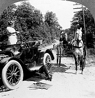 0035902 © Granger - Historical Picture ArchiveCAR AND CARRIAGE, 1914.   A horse and carriage meets a broken down car on a road. The original caption reads: 'Why! Good afternoon! Yes it is a shame. He should have fixed that before we came.' Stereograph, c1914.