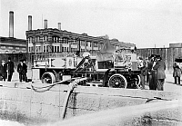 0164220 © Granger - Historical Picture ArchiveFIRE ENGINE, c1911.   Fire engine of the Fire Department of New York being filled with water, c1911.