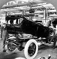 0164222 © Granger - Historical Picture ArchiveDETROIT: AUTO FACTORY, c1917.   Mounting the automobile body onto a chassis, at an automobile factory in Detroit, Michigan. Stereograph, c1917.