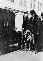 0164231 © Granger - Historical Picture ArchiveNEW YORK: CHIMPANZEE, c1910.   A chimpanzee dressed in a suit closing the door of an automobile in New York City, c1910.