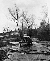 0171678 © Granger - Historical Picture ArchiveMODEL A FORD, 1930.   A Model A Ford crossing a creek bed in Oldham County, Kentucky. Photograph, 1930.