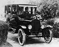 0171681 © Granger - Historical Picture ArchiveFORD SEDAN, 1923.   A family driving a Ford sedan. Photograph, 1923.