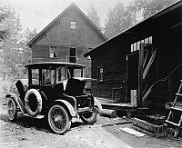 0171713 © Granger - Historical Picture ArchiveELECTRIC CAR, c1919.   Charging the battery of a Detroit Electric automobile. Photograph, c1919.