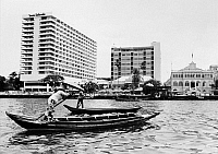 0126872 © Granger - Historical Picture ArchiveBANGKOK: ORIENTAL HOTEL.   Two new buildings surround the 1887 structure of the Oriental Hotel on the Chao Phya River in Bangkok, Thailand. On the right is the Bangkok headquarters of the Danish East Asiatic Company, founded in 1884. Photograph, c1975.