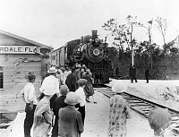 0017884 © Granger - Historical Picture ArchiveRAILROADS: STATIONS.   The arrival of the Orange Blossom Special in Fort Lauderdale, Florida on its first run from Wildwood, New Jersey, completing the East Coast seaboard train connection, c1921.