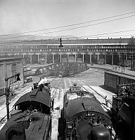 0122688 © Granger - Historical Picture ArchiveCALIFORNIA: RAILROAD, 1943.   Locomotive engines at the roundhouse in San Bernardino, California. Photograph by Jack Delano, March 1943.