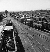 0122971 © Granger - Historical Picture ArchiveRAILROAD YARD, 1943.   The Atchison, Topeka, and Santa Fe Railroad yard in Needles, California. Photograph by Jack Delano, March 1943.
