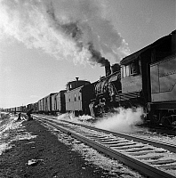 0123036 © Granger - Historical Picture ArchiveFREIGHT TRAIN, 1943.   Changing crews and cabooses on a westbound freight train along the Atchison, Topeka and Santa Fe Railroad, between Chicago and Chillicothe, Illinois. Photograph by Jack Delano, March 1943.