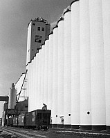 0175980 © Granger - Historical Picture ArchiveAGRICULTURE: GRAIN LOADING.   A Burlington Northern Railroad train being filled with grain from a Farmarco elevator in Lincoln, Nebraska. Photograph, 1977.