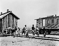 0176022 © Granger - Historical Picture ArchiveRAILROAD: CHINESE WORKERS.   Chinese section hands of the Union Pacific Railroad at the station at Promontory, Utah. Photograph by J.B. Silvis, late 19th century. Silvis' photography car is in the background.