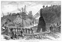 0353477 © Granger - Historical Picture ArchiveRAILROAD WASHOUT, 1885.   Men and women walking across a footbridge due to a washed-out bridge on the New York Central Railroad. Wood engraving, American, 1885.