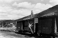 0121624 © Granger - Historical Picture ArchiveFREIGHT CAR, 1940.   Railroad workers on the freight cars of a narrow gauge railway train in Telluride, Colorado. Photograph by Russell Lee, September 1940.