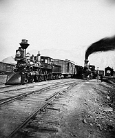 0259755 © Granger - Historical Picture ArchiveSTEAM LOCOMOTIVES.   Steam locomotives at a depot. Photograph, mid to late 19th century.