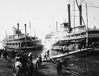 0015528 © Granger - Historical Picture ArchiveSTEAMBOAT LANDING, 1906.   A Mississippi River steamboat landing, 1906.