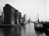 0119726 © Granger - Historical Picture ArchiveBUFFALO: CANAL HARBOR.   Steamboats and grain elevators in the Canal harbor, Buffalo, New York. Photograph c1910-1920.