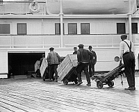 0119730 © Granger - Historical Picture ArchiveLOADING FREIGHT, c1924.   Dockworkers loading cargo onto a steamship. Photograph, c1924.