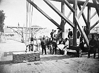 0091899 © Granger - Historical Picture ArchiveALBANY: STATE CAPITOL.   Rope and pulley placing a granite block on the foundation of the New York State Capitol building at Albany. Photographed 7 July 1869.
