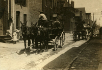 0352126 © Granger - Historical Picture ArchiveBALTIMORE: CARRIAGES, 1910.   Horse-drawn carriages in Fell's Point, Baltimore, Maryland, awaiting workers who will be taken out to work at the berry farms in the surrounding countryside. Photograph by Lewis Hine, May 1910.