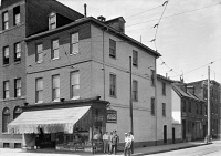 0352130 © Granger - Historical Picture ArchiveBALTIMORE: STOREFRONT.   A storefront on the corner of South Broadway and Shakespeare Street in Fell's Point, Baltimore, Maryland. Photograph by E.H. Pickering, 1936.