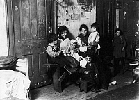 0117336 © Granger - Historical Picture ArchiveCHICAGO: TENEMENT, 1910.   Italian immigrant family in a tenement home, Chicago, Illinois. Photograph by Lewis Hine, 1910.