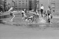 0527311 © Granger - Historical Picture ArchiveCHICAGO, 1941.   Boys playing the the water from a fire hydrant in Chicago, Illinois. Photograph by John Vachon, July 1941.