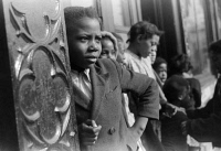 0623033 © Granger - Historical Picture ArchiveCHICAGO: CHILDREN, 1941.   African American children in front of an apartment building on the South Side of Chicago, Illinois. Photograph by Edwin Rosskam, April 1941.