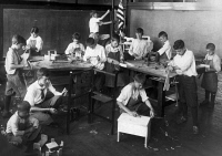 0623048 © Granger - Historical Picture ArchiveCHICAGO: CLASSROOM, 1917.   A woodworking class in an open-air classroom in Chicago, Illinois. Photograph, 1917.