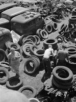 0623053 © Granger - Historical Picture ArchiveCHICAGO: SCRAP YARD, 1942.   An automobile salvage yard, providing scrap metal and rubber for war materials during World War II. Photograph by Ann Rosener, July 1942.