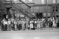 0623055 © Granger - Historical Picture ArchiveCHICAGO: COMMUTERS, 1940.   Commuters waiting for a street car in Chicago, Illinois. Photograph by John Vachon, July 1940.