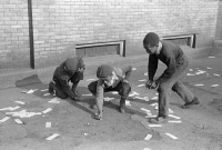 0623067 © Granger - Historical Picture ArchiveCHICAGO: MARBLES, 1941.   A group of African American boys playing marbles outside in Chicago, Illinois. Photograph by Edwin Rosskam, July 1941.