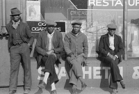 0623070 © Granger - Historical Picture ArchiveCHICAGO: MEN, 1941.   Group of African American men in front of a storefront in Chicago, Illnois. Photograph by Edwin Rosskam, July 1941.