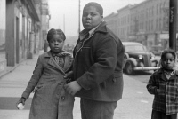 0623074 © Granger - Historical Picture ArchiveCHICAGO: CHILDREN, 1941.   African American children on a street in Chicago, Illinois. Photograph by Edwin Rosskam, April 1941.
