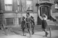 0623109 © Granger - Historical Picture ArchiveCHICAGO: CHILDREN, 1941.   Children jumping rope outside of an apartment building on the South Side of Chicago, Illinois. Photograph by Edwin Rosskam, April 1941.